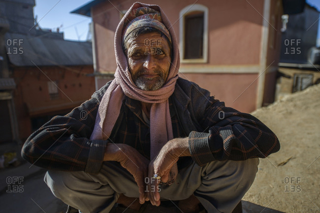 February 7, 2014: Nepalese man in typical sitting pose, Tansen, Nepal