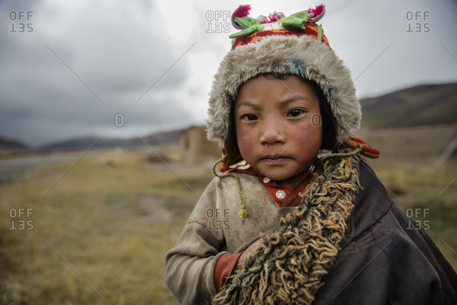 October 5, 2010: Tibetan child in traditional clothing, Sichuan Province, China