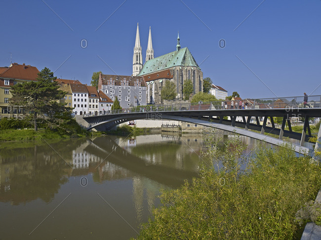 September 7, 2014: Bridge over the river Neisse to the old town with church St. Peter and Paul in Gorlitz, Saxony, Germany