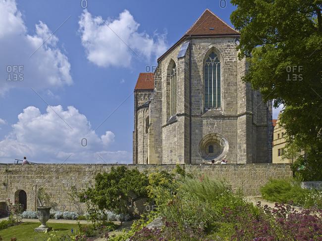 August 8, 2014: Herb garden with collegiate church in Quedlinburg, Saxony-Anhalt, Germany