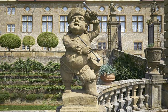 July 20, 2014: Sandstone figure of the drummer at Weikersheim Castle, Main-Tauber-Kreis, Baden-Wurttemberg, Germany
