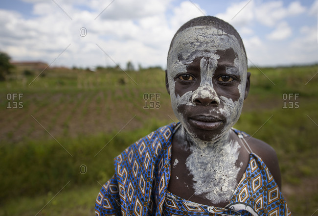 August 11, 2014: Teenager covered with chalk dust during the month before her circumcision, male age ritual, West Kenya, Africa