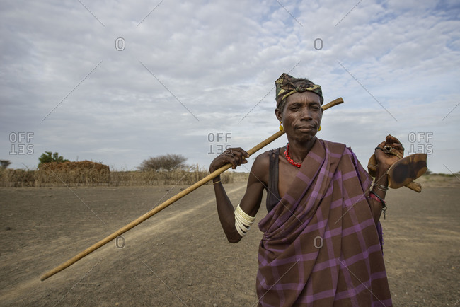 August 2, 2014: A Turkana warrior shows his cane and neck to rest, Kenya