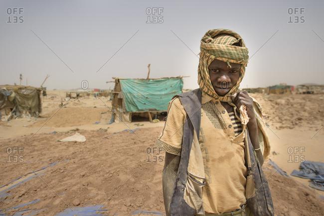 April 25, 2014: Gold prospectors at work in the Delgo gold market in the Sahara, Sudan