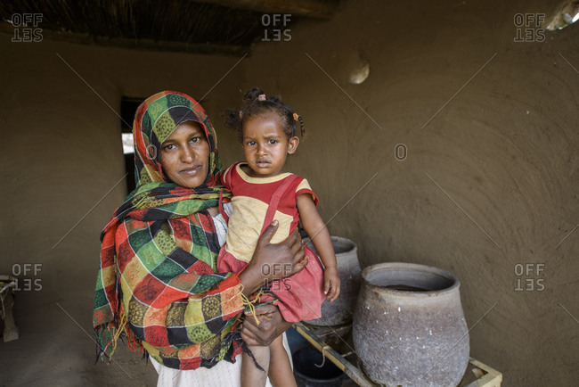 April 23, 2014: Nubian woman with child in the Sahara, Sudan