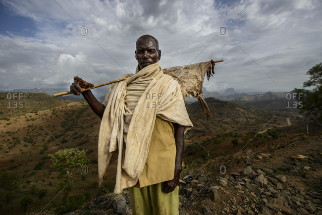 June 20, 2014: A Tigrayan man holds a stick with a dried piece of goatskin, Simien mountains, Ethiopia