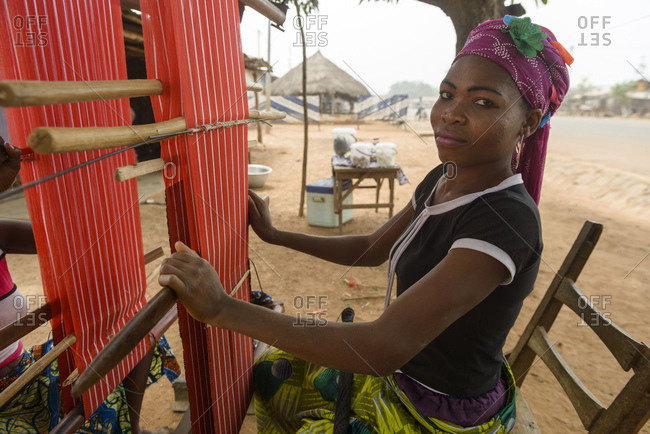 December 4, 2015: Girls and women work on their looms in a village in northern Benin, Africa