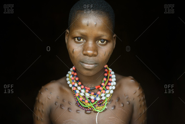 December 2, 2015: Girl with tribal scars from northern Benin, Africa