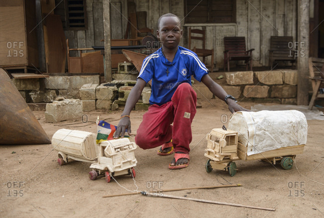 October 6, 2015: Bantu child and homemade toys, Bayanga, Central African Republic, Africa