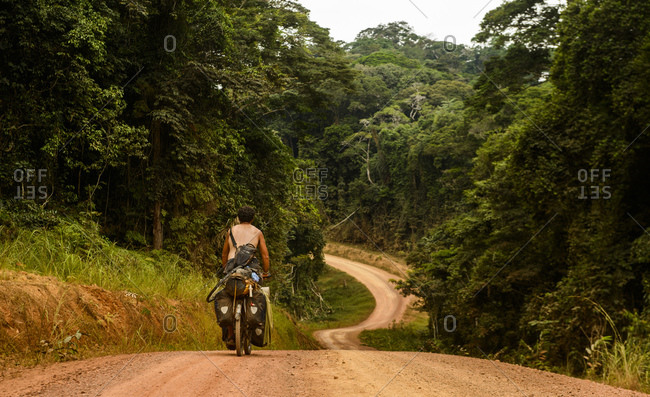 Cycling in Gabon's equatorial rainforest, Central Africa