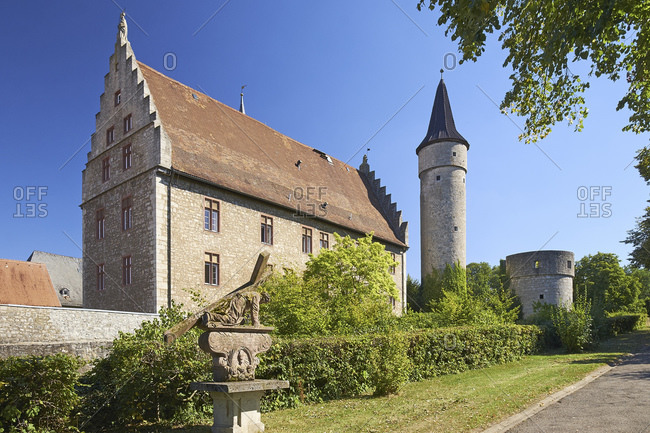 August 24, 2016: Cathedral chapel with thick tower and Nikolausturm in Ochsenfurt, Lower Franconia, Bavaria, Germany