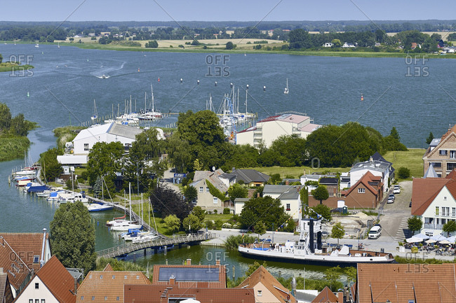 July 24, 2016: View from the Petrikirche to the Peenestrom with sailboat yard, Wolgast, Mecklenburg-Western Pomerania, Germany