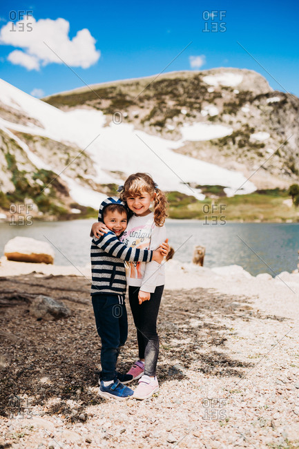 Two young kids standing in front of St. Mary's Glacier in Idaho Springs, Colorado