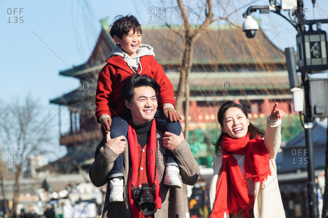 A family of three traveling together