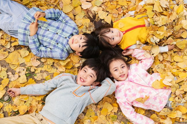 Lovely children lie on the grass together