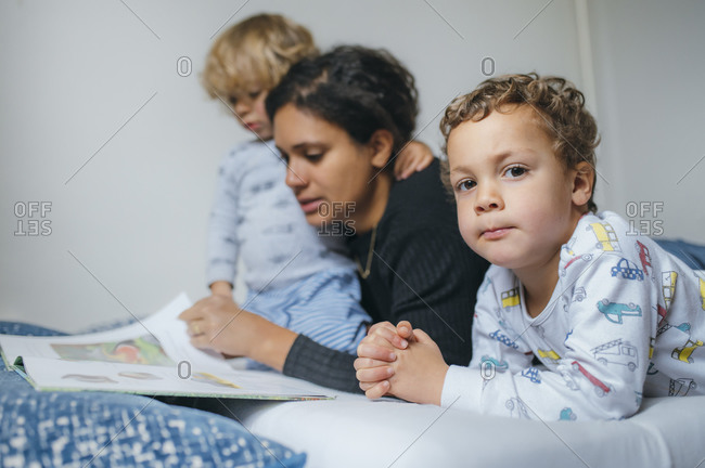 Mother reading books with her sons
