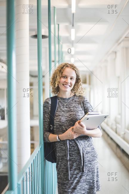 Portrait of female student in corridor of university