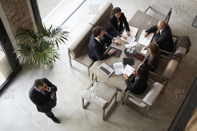 Team of financial advisors planning with business coworkers during meeting at law firm