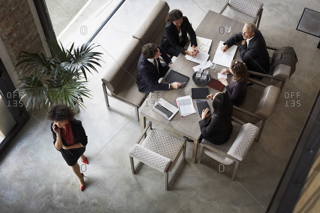 Team of financial advisors planning with business colleagues during meeting at law firm