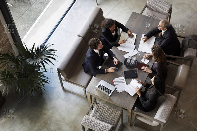 Team of lawyers planning with business colleagues during meeting at law firm