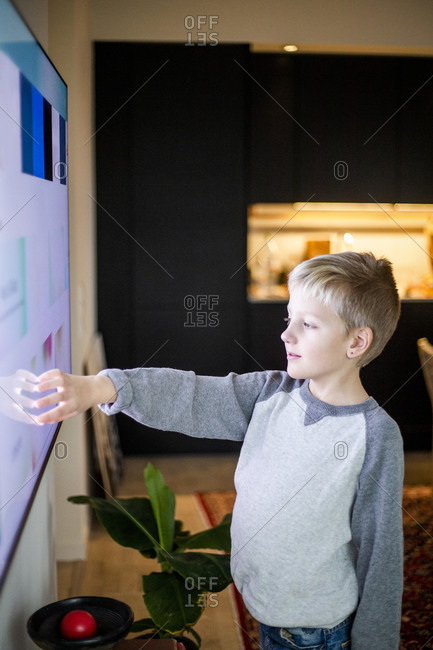 Boy watching smart TV at home
