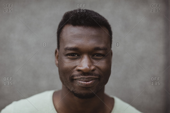 Close-up portrait of smiling man standing outdoors