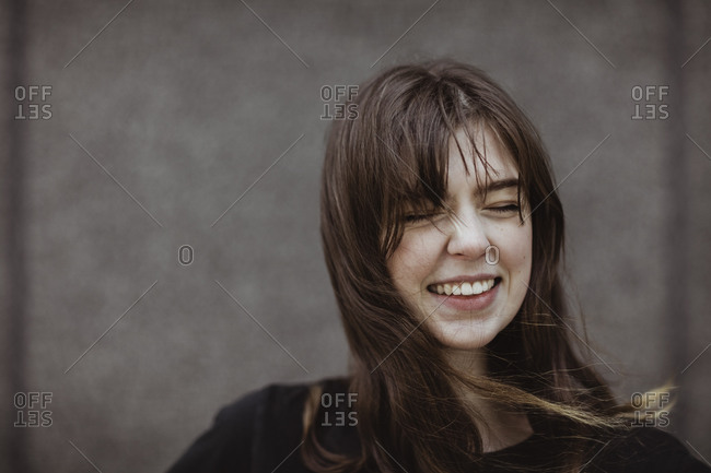 Happy woman with eyes closed standing outdoors