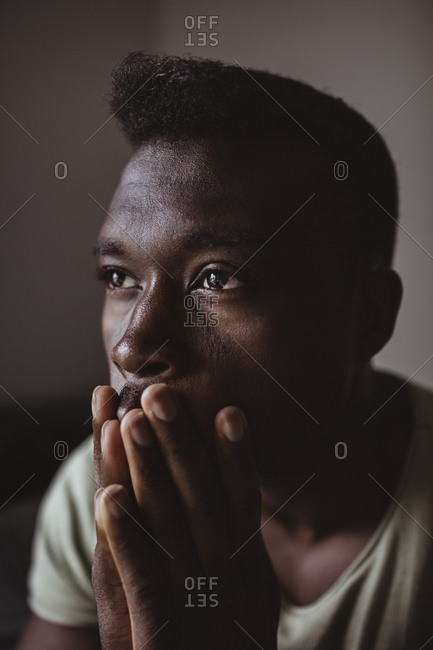 Close-up of stressed man looking away