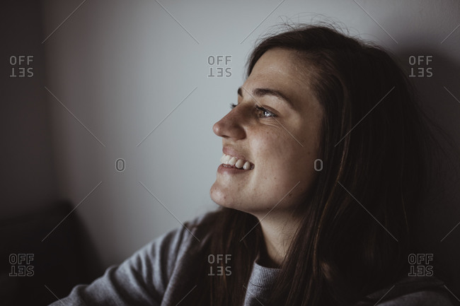 Close-up of smiling woman looking away