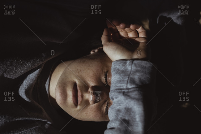 High angle view of sad woman with closed eyes at home