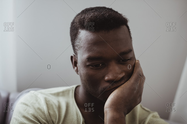 Close-up of worried man at home