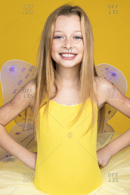 Happy girl with yellow ballet clothes