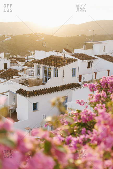 Sunset of a small white town in South Spain with pink Bougainvilleas