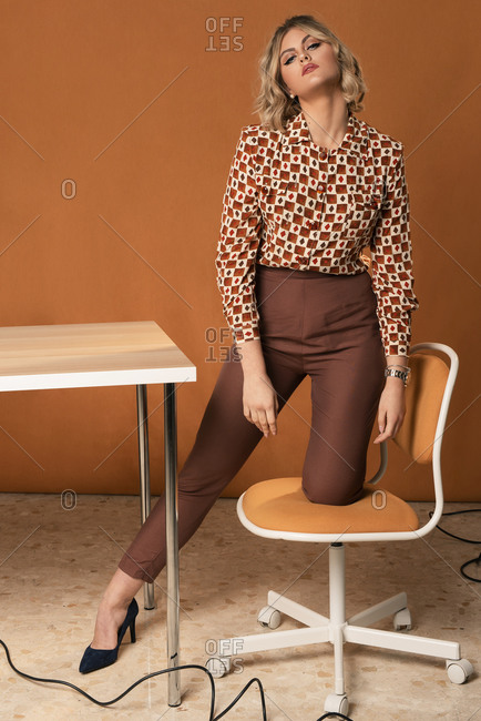 Front view of a business woman with vintage clothing in the office