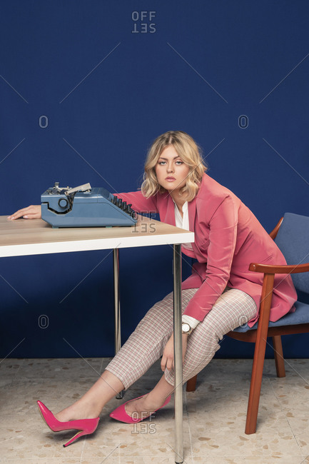 Blonde woman waking up in the office after a long night working