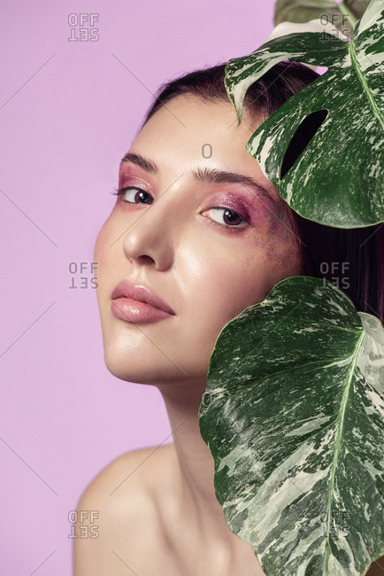 Beauty concept with a Caucasian young woman and plants