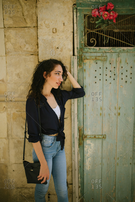 Portrait of a young beautiful woman walking in old town Rabat, Malta