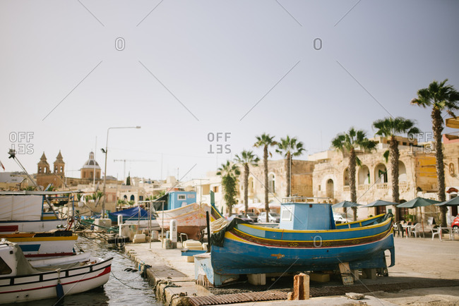 Traditional wooden Maltese fishing boat on a dock