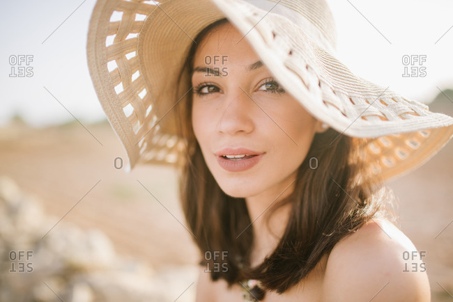 A beautiful young woman wearing sunhat in the desert