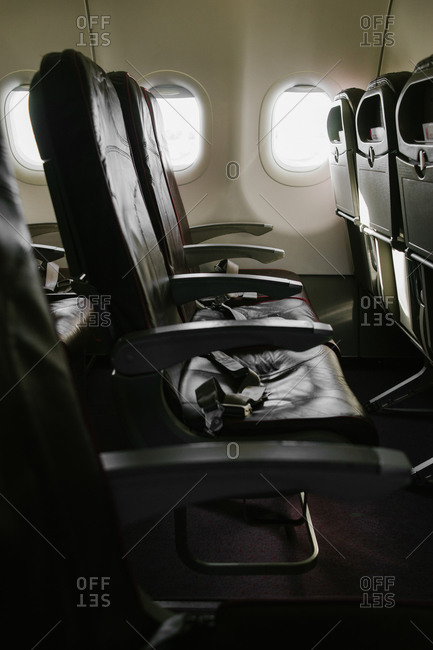 Interior view of airplane seats with nobody in them