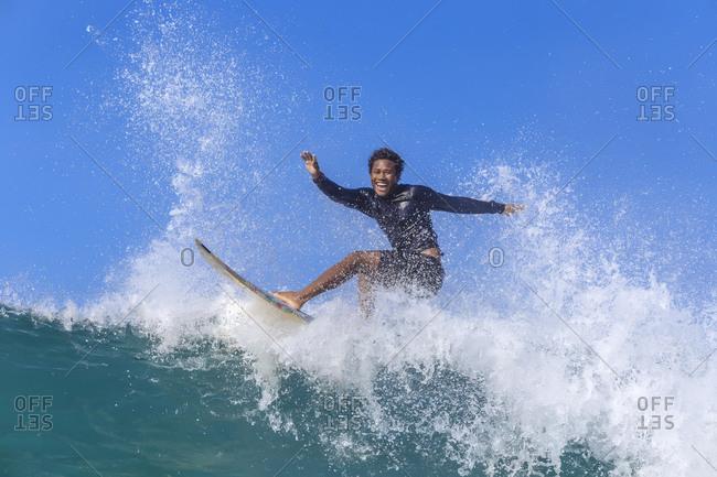 Surfer riding wave, Kuta, Lombok, Indonesia