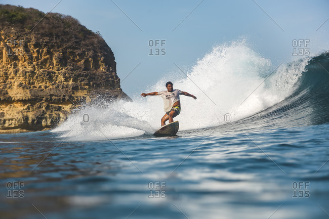 Surfer on wave, Kuta, Lombok, Indonesia