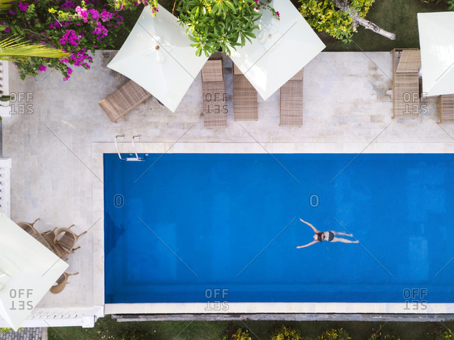 Woman in swimming pool in hotel, Balian, Bali, Indonesia