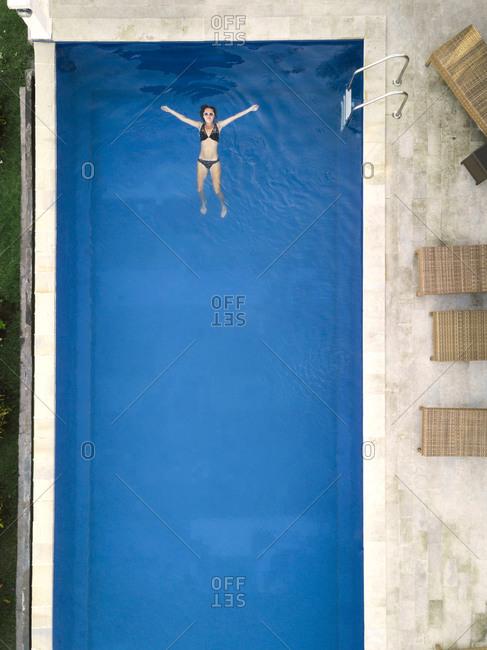 November 3, 2018: Woman in swimming pool in hotel, Balian, Bali, Indonesia