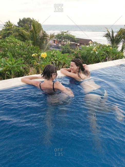 November 3, 2018: Two women in swimming pool in hotel, Balian, Bali, Indonesia