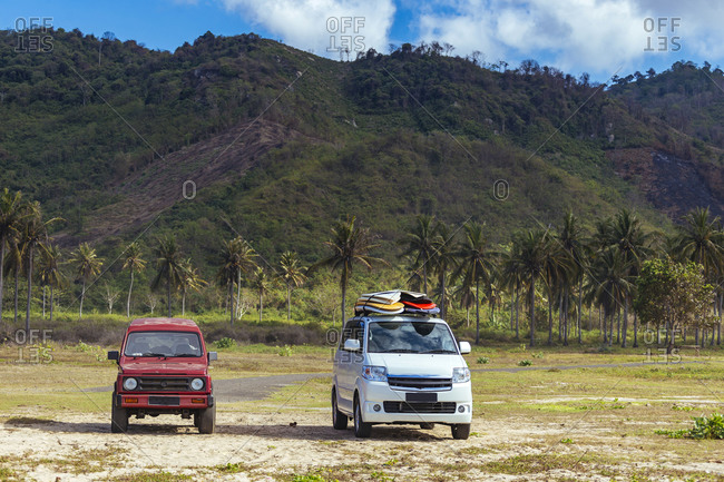 Two cars with surfboards, Lombok, Indonesia
