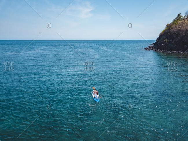 Men kayaking in sea, Amed, Bali, Indonesia
