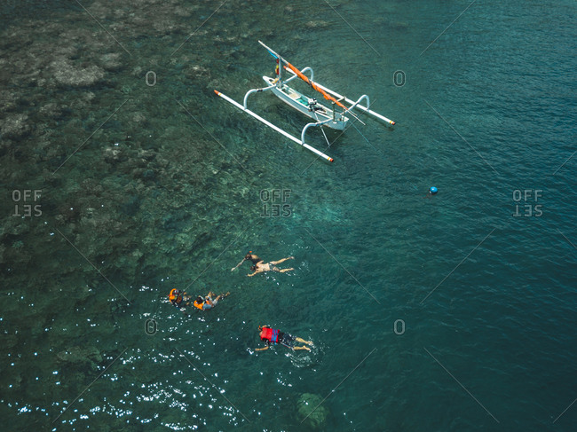 Aerial view of people snorkeling and outrigger boat, Amed, Bali, Indonesia