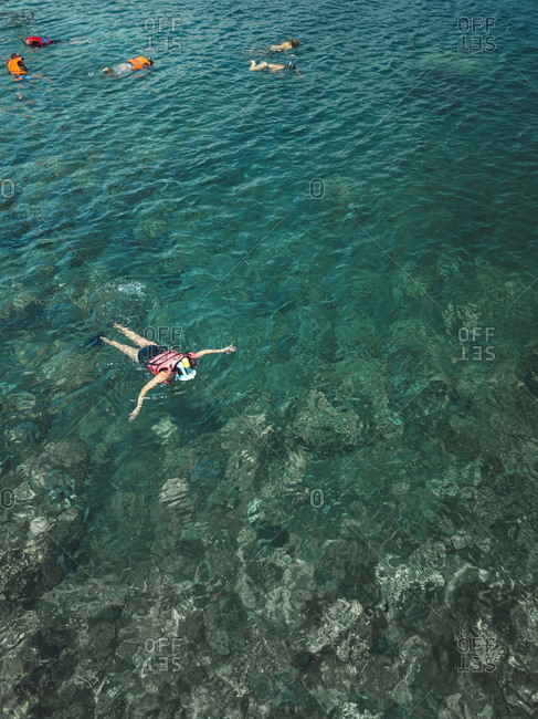 Aerial view of people snorkeling, Amed, Bali, Indonesia