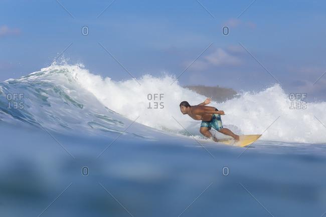 Man surfing in sea, Kuta, Lombok, Indonesia